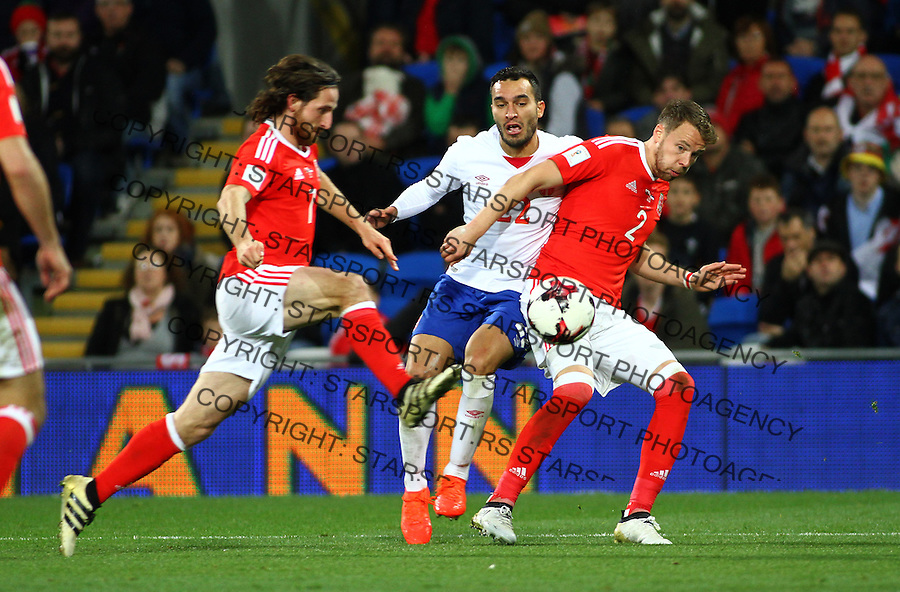 (copyright &amp; photo: STARSPORT)<br /> 12.11.16 World Cup Qualifier -  European Group D - Wales v Serbia -<br /> Ivan Obradovic of Serbia is tackled by Joe Allen (L) and Chris Gunter of Wales