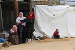 Palestinian family sits next to her destroyed house, on a winter cold day, in Khan Youns southern in Gaza city January 20, 2020. Photo by Ashraf Amra