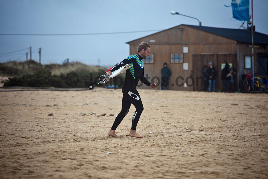 TOM WHITAKER (AUS)   Peniche, Portugal (Wednesday, October 21, 2009) - Organisers of the Rip Curl Pro woke this morning to massive destruction of the main contest site at Supertubes. Despite building sand levies over the past two days double up waves between 3 and 4 meters washed through the site around 4am this morning. The force of the waves caused damage to almost all of the contest infrastructure. Huge shipping containers being used for offices and storage were actually floating around the site as the water washed through. Hundreds of thousands of dollars worth of damage has been caused by the huge seas to audio, video and computer equipment as well as structural damage to the buildings..Luckily the contest has a back up site at Baleal. The contest was called off again today because of the huge storm surf. Another call will be made at 8 am tomorrow...The Rip Curl Pro Search which will culminate the European leg of the 2009 ASP Men's World Tour in the wave abundant Portuguese region of Peniche was called off again today due strong onshore winds, driving rain and rough surf. The contest is hosting the world's best surfers from October 19 - 30, 2009 and will run when conditions are favorable...Event No. 9 of 10 on the 2009 ASP World Tour, the Rip Curl Pro Search is poised to deliver high drama with projected sizable swells setting the scene for a possible ASP World Title showdown and several requalification campaigns...Mick Fanning (AUS), 28, former ASP World Champion (2007) and current ASP World No. 1, has been on a rampage during the back half of the season, claiming back-to-back wins in California and France before taking the ASP ratings' lead last week in Spain. If Fanning finishes higher than 3rd at the Rip Curl Pro Search in Portugal, the Australian could claim the 2009 ASP World Title in Europe, contingent upon the finishes of other frontrunners...Photo: Joliphotos.com