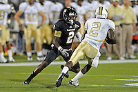 17 September 2011:  FIU defensive back Junior Mertile (2) prepares to tackle UCF quarterback Jeff Godfrey (2) in the third quarter as the FIU Golden Panthers defeated the University of Central Florida Golden Knights, 17-10, at FIU Stadium in Miami, Florida.