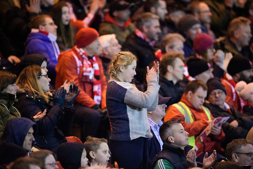 Lincoln City fans watch their team in action<br /> <br /> Photographer Chris Vaughan/CameraSport<br /> <br /> The EFL Sky Bet League Two - Lincoln City v Exeter City - Tuesday 26th February 2019 - Sincil Bank - Lincoln<br /> <br /> World Copyright © 2019 CameraSport. All rights reserved. 43 Linden Ave. Countesthorpe. Leicester. England. LE8 5PG - Tel: +44 (0) 116 277 4147 - admin@camerasport.com - www.camerasport.com
