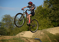 NWA Democrat-Gazette/BEN GOFF @NWABENGOFF<br /> Nicolas Daughrity hits the dirt jumps in the freeride park after racing in the Junior men's age 11-12 race on Sunday Oct. 2, 2016 during the annual Slaughter Pen Jam at the Slaughter Pen trails in Bentonville. Sunday concluded the three-day festival with cross country races that were part of the Monster Energy Arkansas Mountain Bike Championship Series.