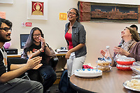 Cynthia Tim, 20, (center) laughs as she tells those assembled to start eating at a Lunar New Year celebration at Middlesex Community College's Asian American Connections Center on Thurs., Feb. 15, 2018. Tim is a Cambodian-American and a second year student at Middlesex Community College studying Business. The Asian American Connections Center was established at the school using a federal grant in 2016 and serves as a focal point for the Asian community at the school, predominantly Cambodian, to gather, socialize, study, and otherwise take part in student life.