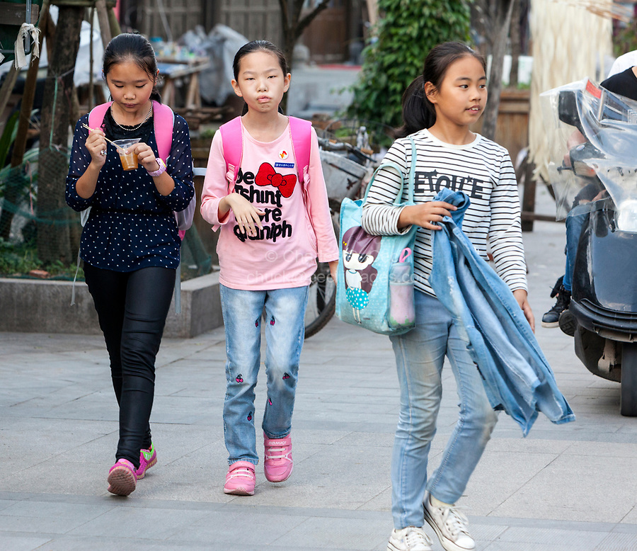 Yantou, Yongjia, Zhejiang, China.  Teenage Girls Walking Home after School.