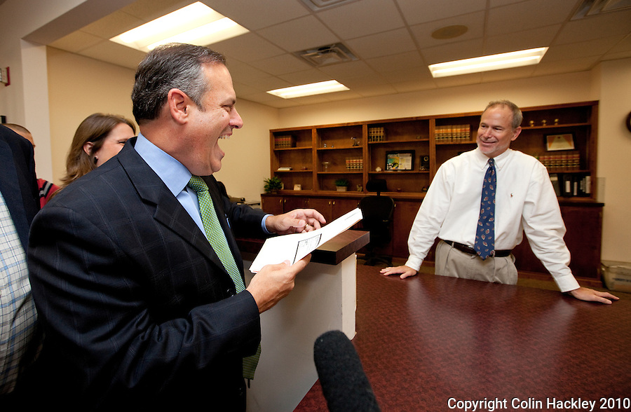 TALLAHASSEE, FLA. 6/17/10-MADDOX 61710-Scott Maddox, democratic candidate for Agricultural Commissioner, left, talks with Joel Mynard in the Division of Elections office as he files his campaign paper work Thursday in Tallahassee...COLIN HACKLEY PHOTO