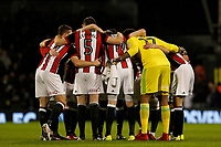 Sheffield United FC huddle before the whistle during the Sky Bet Championship match between Fulham and Sheff United at Craven Cottage, London, England on 6 March 2018. Photo by Carlton Myrie.
