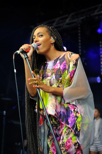 Solange (Solange Knowles) <br /> performing at Glastonbury Festival, Worthy Farm, Pilton, Somerset, <br /> England, UK, 28th June 2013.<br /> half length music gig concert gig live on stage singing long hair braids singing   microphone pink yellow white print catsuit jumpsuit <br /> CAP/MAR<br /> &copy; Martin Harris/Capital Pictures