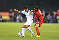 Washington, D.C.- May 29, 2014. Honduras midfielder Andy Najar goes against Turkey  midfielder Olcay Sahan.  Turkey defeated Honduras 2-0 during an international friendly game at RFK Stadium.