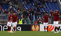 Calcio, Europa League: Ritorno degli ottavi di finale Roma vs Fiorentina. Roma, stadio Olimpico, 19 marzo 2015.<br /> From left, Roma's Kostas Manolas, Alessandro Florenzi, Seydou Keita and Daniele De Rossi reacts after Fiorentina scored for the third time during the Europa League round of 16 second leg football match between Roma and Fiorentina at Rome's Olympic stadium, 19 March 2015.<br /> UPDATE IMAGES PRESS/Riccardo De Luca