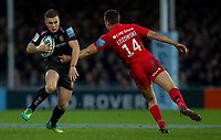 Exeter Chiefs' Joe Simmonds evades the tackle of Saracens' Alex Lozowski<br /> <br /> Photographer Bob Bradford/CameraSport<br /> <br /> Gallagher Premiership Round 10 - Exeter Chiefs v Saracens - Saturday 22nd December 2018 - Sandy Park - Exeter<br /> <br /> World Copyright © 2018 CameraSport. All rights reserved. 43 Linden Ave. Countesthorpe. Leicester. England. LE8 5PG - Tel: +44 (0) 116 277 4147 - admin@camerasport.com - www.camerasport.com
