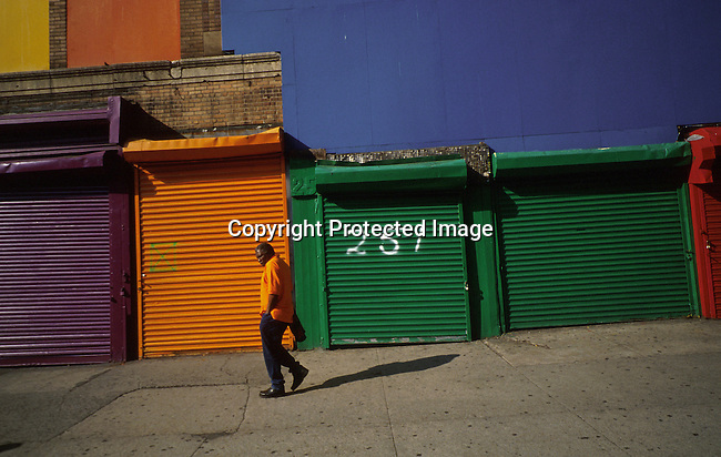 A man walking past some closed shops at Times Square on April 24, 1997 in New York City, New York, USA. Times Square has been totally renovated and upgraded and most sex shops and thieves have dissapeared.  Theme restaurants and financial companies has moved in..(Photo: Per-Anders Pettersson/ Liaison Agency)