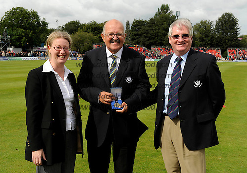 Scotland V Australia ODI at Grange CC, Edinburgh - Shona Robison, Minister for Public Health and Sport in the Scottish Government left) and Jim Young, President, Cricket Scotland (right), presents Sandy Scotland with his ICC Centenary Medal, to mark his cricket volunteer achievements over a numbers of years in Scotland - Picture by Donald MacLeod 28.08.09