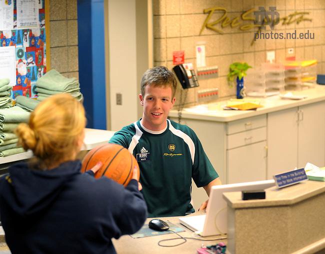 Matt Storey at the RSRC front desk..Photo by Matt Cashore/University of Notre Dame