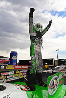 Jul, 22, 2012; Morrison, CO, USA: NHRA funny car driver Jack Beckman celebrates after winning the Mile High Nationals at Bandimere Speedway. Mandatory Credit: Mark J. Rebilas-US PRESSWIRE