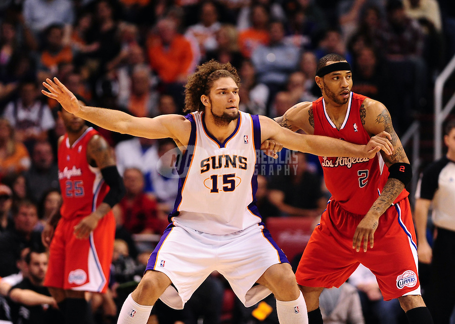 Mar. 2, 2012; Phoenix, AZ, USA; Phoenix Suns center Robin Lopez (15) against Los Angeles Clippers forward Kenyon Martin at the US Airways Center. The Suns defeated the Clippers 81-78. Mandatory Credit: Mark J. Rebilas-USA TODAY Sports