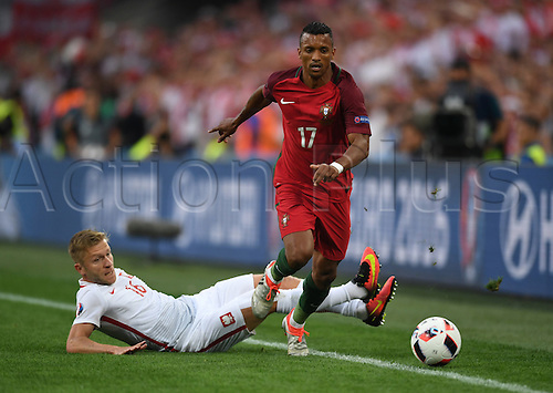 30.06.2016. Marseille, France.  Jakub Blaszczykowski (L) of Poland tackles Nani of Portugal for the ball during the UEFA EURO 2016 quarter final soccer match between Poland and Portugal at the Stade Velodrome in Marseille, France, 30 June 2016.