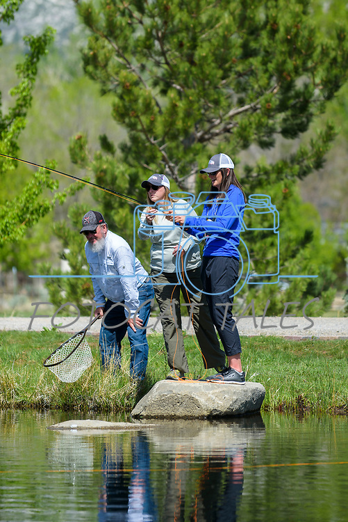 Holly Kuhlmann learns to fly fish with the help of Whitney Inmon and Tom Peterson during the Casting for Recovery fishing clinic at Bently Ranch in Gardnerville, Nev. May 4, 2018.<br /> Photo by Candice Vivien/Nevada Momentum