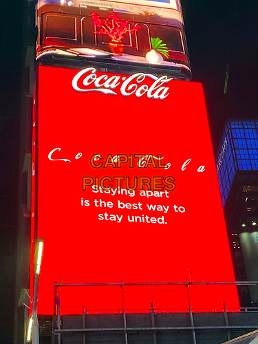 NEW YORK, NY - MARCH 24: A Coca-Cola digital sign promoting social distancing due to the coronavirus pandemic in New York City on March 24, 2020. <br /> CAP/MPI/RMP<br /> ©RMP/MPI/Capital Pictures