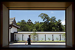 A man walks through the grounds of the Matsue History Museum in Matsue City, Shimane Prefecture, Japan on 26 June 2011. Matsue Castle was completed in 1611. Photographer: Robert Gilhooly