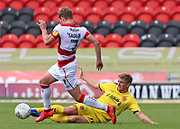 Doncaster Rovers' Kieran Sadlier is tackled by Fleetwood Town's Jack Sowerby<br /> <br /> Photographer David Shipman/CameraSport<br /> <br /> The EFL Sky Bet League One - Doncaster Rovers v Fleetwood Town - Saturday 17th August 2019  - Keepmoat Stadium - Doncaster<br /> <br /> World Copyright © 2019 CameraSport. All rights reserved. 43 Linden Ave. Countesthorpe. Leicester. England. LE8 5PG - Tel: +44 (0) 116 277 4147 - admin@camerasport.com - www.camerasport.com