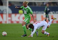 FUSSBALL   1. BUNDESLIGA  SAISON 2012/2013   3. Spieltag FC Augsburg - VfL Wolfsburg           14.09.2012 Simon Kjaer (li, VfL Wolfsburg)  gegen Daniel Baier (FC Augsburg)