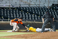 AZL Giants third baseman Jacob Gonzalez (52) applies the tag to Lazaro Armenteros for an out during the game against the AZL Athletics on August 5, 2017 at Scottsdale Stadium in Scottsdale, Arizona. AZL Athletics defeated the AZL Giants 2-1. (Zachary Lucy/Four Seam Images)