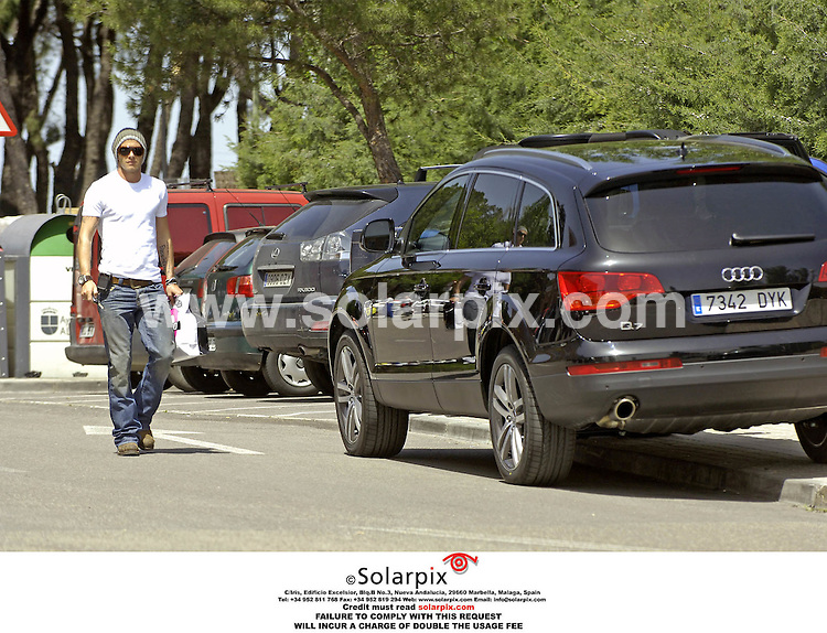 ALL-ROUND EXCLUSIVE PICTURES FROM SOLARPIX.COM.*MUST CREDIT SOLARPIX.COM OR DOUBLE FEE INCURRED*.*NO SYNDICATION IN SPAIN*.David Beckham was out in Madrid today in his new Audi Q7 SUV. The vehicle was given to him this morning by Audi, who supply the Real Madrid football team with a new car every year. David was doing a spot of shopping while wife Victoria was busy doing exactly the same thing in London. 24.04.06.REF: 2278 RAP