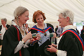 Lecturer (on the left) and two adult education graduates celebrating, University of Surrey.