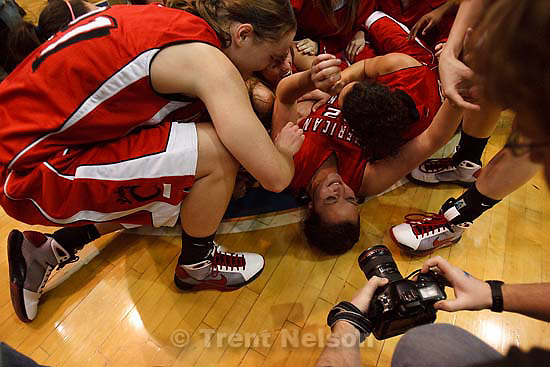 Taylorsville - American Fork players collapse in a dog pile at center court, celebrating their championship win over Riverton. Riverton vs. American Fork High School girls basketball, 5A State Championship game Saturday February 28, 2009 at Salt Lake Community College..craig dilger