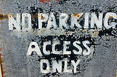 """Orford, Suffolk; very weathered sign """"No Parking Access Only""""."""