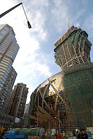 "The New Lisboa Casino, owned by local tycoon Stanley Ho, under construction"" in Macau. Macau is an ex-Portuguese colony, a cluster of islands and a peninsula in the South China Sea, that was handed back to the Chinese in 1999. It has a strong Chinese flavour but also retains many colonial buildings as well as becomming known as the Vegas of the Far East with a plethero of new Casino's in operation and more being built..07 Dec 2006"
