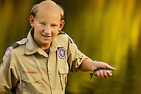 A Boy Scout, who partially shaved his head as a Boy Scout camp tradition, shows off a fish he caught while attending Boy Scout resident camp in summer 2010 at Camp Raven Knob. Camp Raven Knob Scout Reservation, one of the largest Boy Scout camps in the United States, is located within Boy Scouts of America's Old Hickory Council in Mt. Airy, North Carolina. Troops from across the US attend the camp's one-week residential boys' summer programs, which offer instruction on more than 40 merit badges, adventure programs and new Scout orientation.