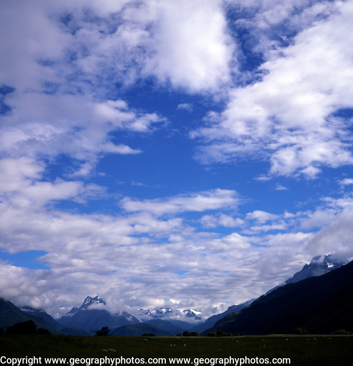 Cumulus clouds in blue sky over mountains, Glenorchy, South Island, New Zealand