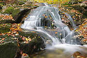 Cascade along Clough Mine Brook, a tributary of Lost River, in Kinsman Notch of Woodstock, New Hampshire USA during the autumn months.