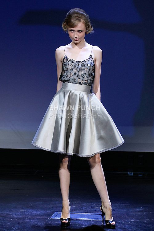 """Lexi poses in an outfit from the Douglas Hannant Spring 2013 """"A Daydream"""" collection, at the New York Historical Society, during New York Fashion Week Spring 2013."""