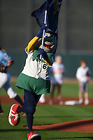 Cedar Rapids Kernels mascot Mr. Shucks runs on the field with the team flag before a game against the Quad Cities River Bandits on August 19, 2014 at Perfect Game Field at Veterans Memorial Stadium in Cedar Rapids, Iowa.  Cedar Rapids defeated Quad Cities 5-3.  (Mike Janes/Four Seam Images)