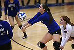 Marymount's Erin Allison passes in a college volleyball match against PSU Harrisburg at Marymount University in Arlington, Vir., on Wednesday, Oct. 9, 2013.<br /> Photo by Cathleen Allison