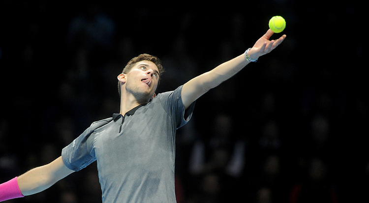 Dominic Thiem (AUT) in action against Roger Federer (SUI) in their Group Lleyton Hewitt match<br /> <br /> Photographer Hannah Fountain/CameraSport<br /> <br /> International Tennis - Nitto ATP World Tour Finals Day 3 - O2 Arena - London - Tuesday 13th November 2018<br /> <br /> World Copyright © 2018 CameraSport. All rights reserved. 43 Linden Ave. Countesthorpe. Leicester. England. LE8 5PG - Tel: +44 (0) 116 277 4147 - admin@camerasport.com - www.camerasport.com