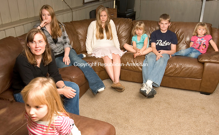 SOUTHBURY, CT 26 November 2008-112608SV11--From left, Ann Ward of Southbury Watches herself on the TV show Who Want&rsquo;s to be a Millionaire with her six children Megan, 6, Katie, 15, Julia, 17, Marissa, 4, Grant, 12, and Annie, 2 in their Southbury home Wednesday. Ward ended up winning $16,000. <br /> Steven Valenti Republican-American
