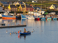 County Kerry, Ireland:<br /> Fisherman and the colorful waterfront of Portmagee, Iveragh peninsula at sunrise