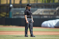 Umpire Jennifer Pawol handles the calls on the bases during the South Atlantic League game between the Lakewood BlueClaws and Hickory Crawdads at L.P. Frans Stadium on April 28, 2019 in Hickory, North Carolina. The Crawdads defeated the BlueClaws 10-3. (Brian Westerholt/Four Seam Images)