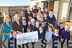 ALL FOR HAITI: Killahan national school pupils and staff present the proceeds of their fundraising for the victims of the Haiti earthquake to Oxfam Tralee representatives Mary Kelly and Kathleen Rogers.