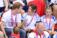 PICTURE BY ALEX BROADWAY /SWPIX.COM - 2012 London Paralympic Games - Day Six - Swimming, Aquatic Centre, Olympic Park, London, England - 04/09/12 - Prince Harry, Nyree Kindred and Emma Hollis watch from the stands.