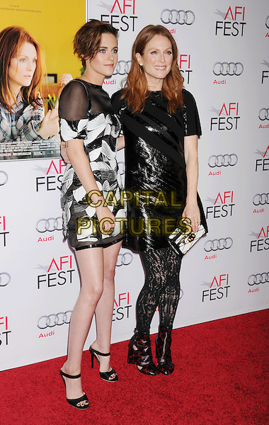 HOLLYWOOD, CA - NOVEMBER 12: Actresses Kristen Stewart; Julianne Moore arrive at the AFI FEST 2014 Presented By Audi - 'Still Alice' Premiere at Dolby Theatre on November 12, 2014 in Hollywood, California.<br /> CAP/ROT/TM<br /> &copy;TM/Roth Stock/Capital Pictures