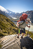 NEW ZEALAND, Aoraki Mount Cook National Park, Hut Caretaker hikes up the Mueller Track, Ben M Thomas