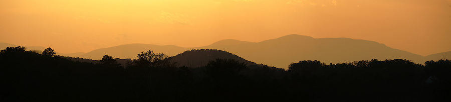 Sunset over Blue Ridge mountains off Barracks Road in Charlottesville, VA. Photo/Andrew Shurtleff