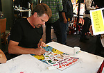 """Robert Newman - GL """"Josh Lewis"""" signs poster attends the 22nd Annual Broadway Flea Market and Grand Auction to benefit Broadway Cares / Equity Fights Aids on Sunday 21, 2008 in Shubert Alley, New York City, NY. (Photo by Sue Coflin/Max Photos)"""