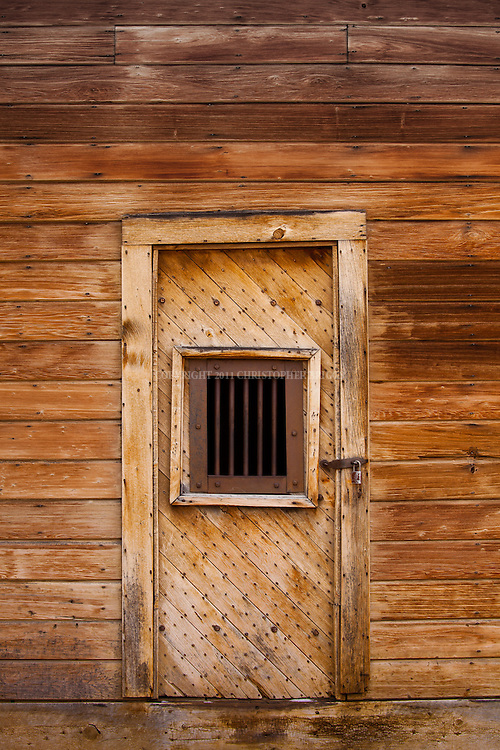 Back door to the Town Jail, one of fewer than 170 structures remaining in the ghost town of Bodie; gold discovered here in 1859. One prisoner is known to have escaped. Designated National Historic Landmark in 1961; 1962 it became Bodie State Historic Park. Bodie named California's official state gold rush ghost town. Historic District, California State Park. Mono County, CA.