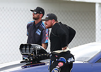 Aug 31, 2018; Clermont, IN, USA; NHRA pro mod driver Steven Whiteley with crew member during qualifying for the US Nationals at Lucas Oil Raceway. Mandatory Credit: Mark J. Rebilas-USA TODAY Sports