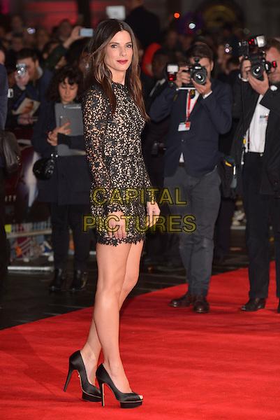 Sandra Bullock<br /> 'Gravity' premiere at the BFI London Film Festival, Odeon cinema, Leicester Square, London, England 10th October 2013.<br /> LFF arrivals full length black long sleeve lace dress mini peep toe high platform heels shoes <br /> CAP/PL<br /> &copy;Phil Loftus/Capital Pictures